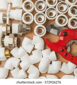Set plumbing and tools on a white background. The fit, adjustable wrench for plumbing pipes and fittings