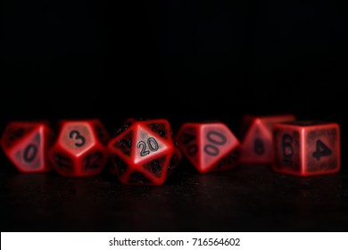 A set of polyhedral dice on a slate surface. These dice are used for role playing games.