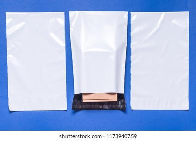 Set of polythene envelopes on blue background