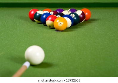A set of pool or billiard ball on a green felt table
