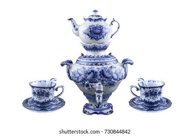 A set of porcelain tableware tea from a samovar with a teapot and two cups and saucers, made in Gzhel style. Closeup. Isolated on white.