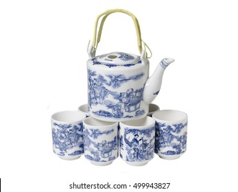 Set of porcelain tableware. Teapot and cups whith a pattern in the Chinese style.