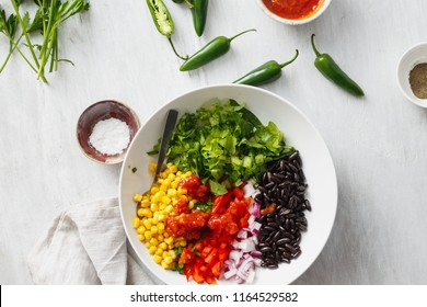 Set of prepared products for the cooking of taco salad on white wooden table, top view