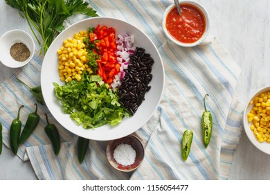 Set of prepared products for the preparation of taco salad, top view
