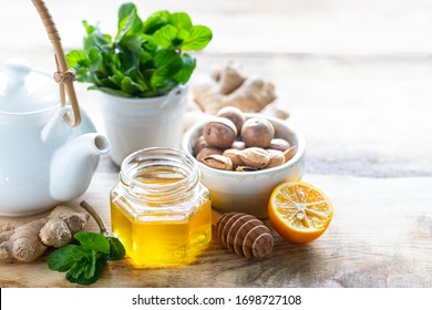 set of products to boost the immune system. Honey, lemon, nuts, ginger to Immunity boosting. copy space.