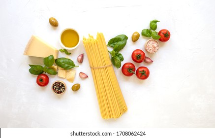 Set of products for cooking traditional italian pasta. Raw ingredients, top view