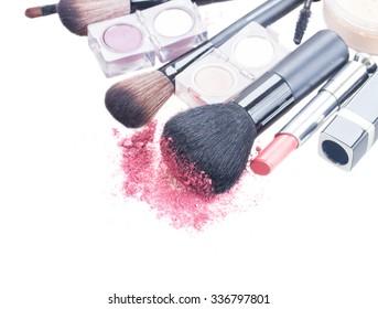 set of  professilonal brushes, lipsticks and  eye  shadows isolated on white background