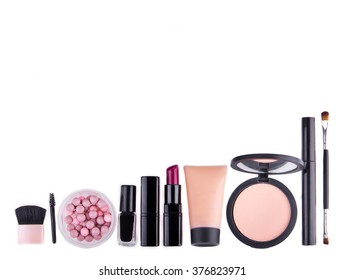 Set of professional cosmetic: make-up mascara, shadows, lipstick, nail polish - partly isolated with shadows on white background. Overhead view. Place for text.