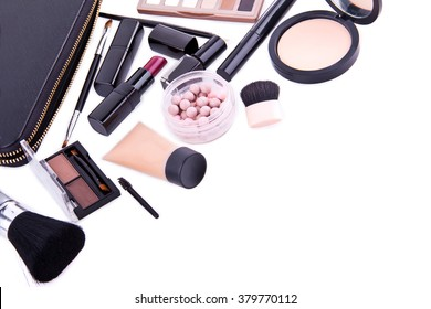 Set of professional cosmetic: make-up mascara, shadows, lipstick, nail polish - partly isolated with shadows on white background in random order. Overhead view. Place for text.