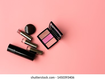 Set of Professional Cosmetic:Various of  Lipstics, make up shade  on a Pink Background. Top View. Copy Space for text