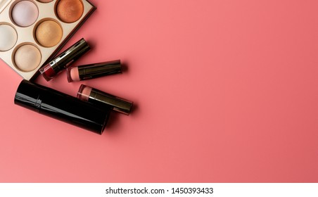 Set of Professional Cosmetic:Various of  Lipstics, palette of make up shade  on a Pink Background. Top View. Copy Space for text