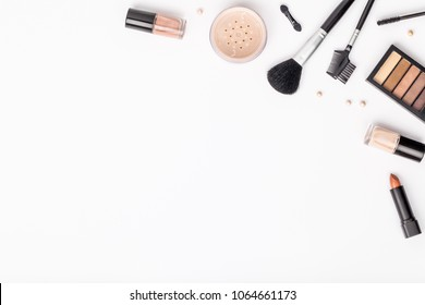 set of professional decorative cosmetics, makeup tools and accessory on white background with copy space for text. beauty, fashion, party and shopping concept. flat lay composition, top view