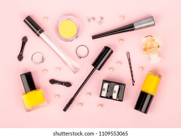 set of professional decorative cosmetics, makeup tools and accessory on blue background. beauty and fashion concept. flat lay composition, top view