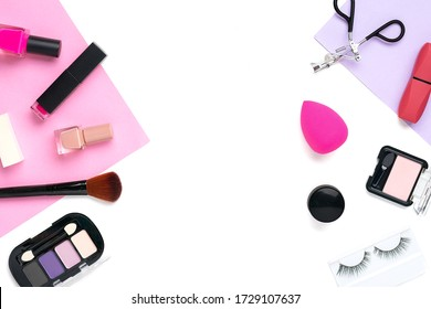 Set of professional decorative cosmetics, makeup tools and accessory of trendy pink color isolated on purple and  white background  Beauty, fashion, party, shopping concept Flat lay composition