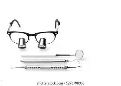 Set of Professional Dentist medical equipment tools and surgical loupe in Dental office. Dental hygiene and health conceptual image.