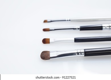 Set of professional eye makeup brushes in white background.