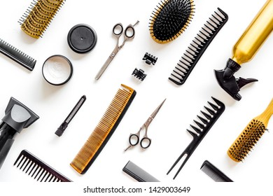 Set of professional hairdresser tools with combs and styling on white background top view pattern
