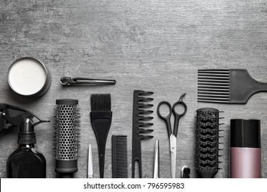 Set of professional hairdresser tools on light grey background