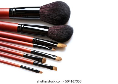 Set of professional makeup brushes with natural hair on white background
