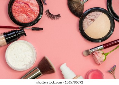 Set for professional makeup, different brushes for applying powder and eyeshadow. Cosmetics and Foundation, concept on pink background