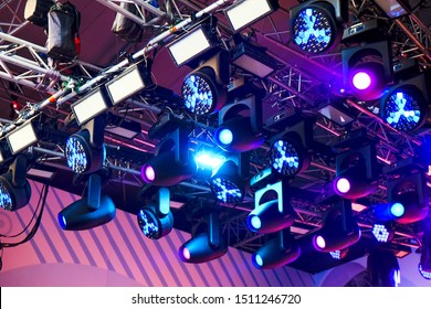 Set of professional stage lighting equipment for gig illumination.Floodlights,several powerful stage light,used to illuminate also sports field,stage,exterior of building.Stage illumination.SOFT FOCUS