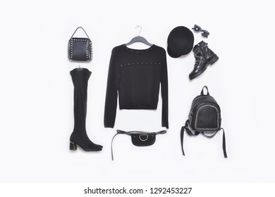 Set of punk rivets handbag with hat, black boots shoes, sunglasses with black sweater on hanging