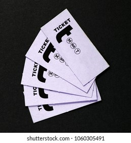 A set of purple multiple purpose transportation tickets.