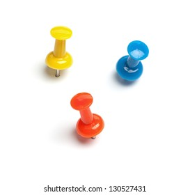 Set of push pins in different colors, with real shadows, isolated on white background.