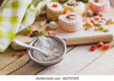 Set of rahat lokum with candied peels, nuts and sugar powder, soft focus background