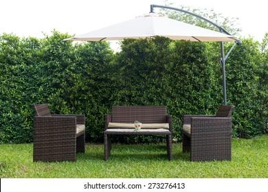 Set of rattan garden furniture under a big garden umbrella,clipping path