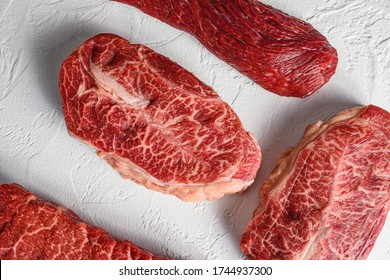 Set of raw denver, top blade, tri tip steak, machete, flank, bavette London broil marble beef on white background top view close up