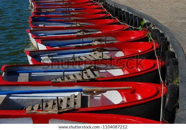 set of recreational rowing boats in the pond of the Casa de Campo in Madrid. Spain