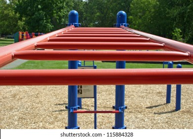 A set of red bars in an empty playground