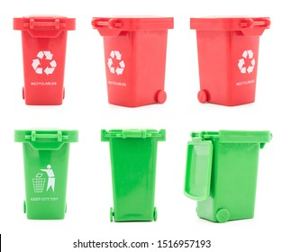 Set of red and green plastic trash can toys isolated on white background