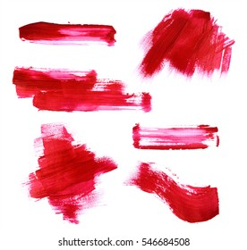 Set of red paint strokes isolated on white background.