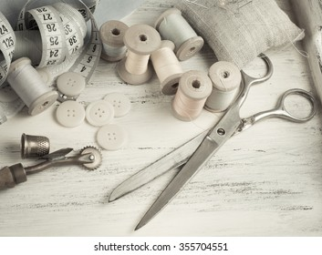 Set of reel of thread, scissors, buttons, fabric and pins for sewing and needlework in Shabby Chic style. For this photo applied toning in retro style.
