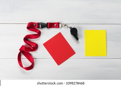set for referee soccer game whistle and two cards on a light background
