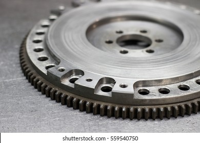 Set to replace the automobile clutch (composed of damping flywheel, drive and basket) on a metal background