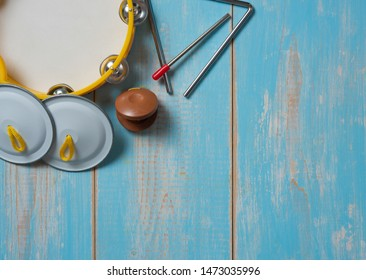 Set of rhythm tambourine, metronome,cymbals on wood table,Music festival and study and school advertising concept.