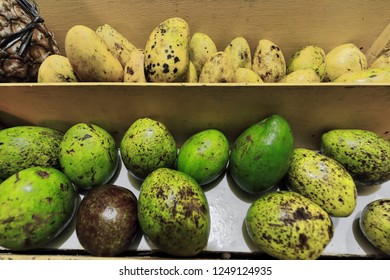 Set of ripe Carabao yellow and green mangoes-national fruit of the Philippines for sale in a sidewalk fruit stand at the back of beachfront houses-Buena Suerte barangay. El Nido-Palawan-Philippines.
