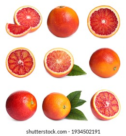 Set with ripe red oranges on white background