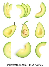 Set with ripe sliced avocados on white background, top view