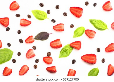 set of roasted coffee beans, pieces of strawberry and sheets of basil isolated on white background, closeup