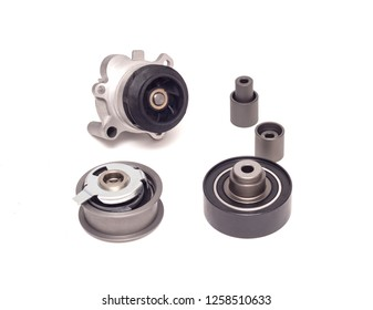 Set of rollers of the automobile engine timing system and the cooling pump on a white background, repair