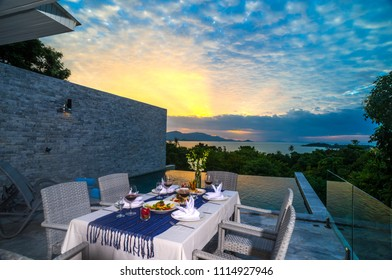 Set up romantic dinner by the sea during the amazing sky with Thai foods and glass of wine on the table Koh Samui Thailand
