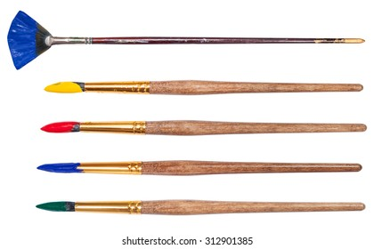 set of round artistic paintbrushes with painted tips isolated on white background