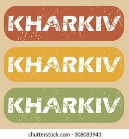 Set of rubber stamps with city name Kharkiv on colored background