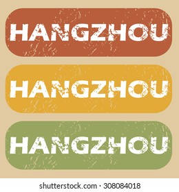 Set of rubber stamps with city name Hangzhou on colored background