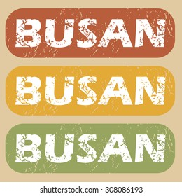 Set of rubber stamps with city name Busan on colored background