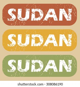 Set of rubber stamps with country name Sudan on colored background
